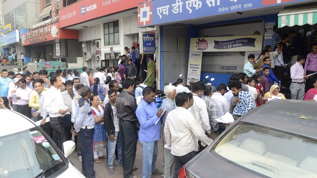 People wait outside banks to exchange currency notes in New Delhi on 11 November 2016. (Photo: IANS)