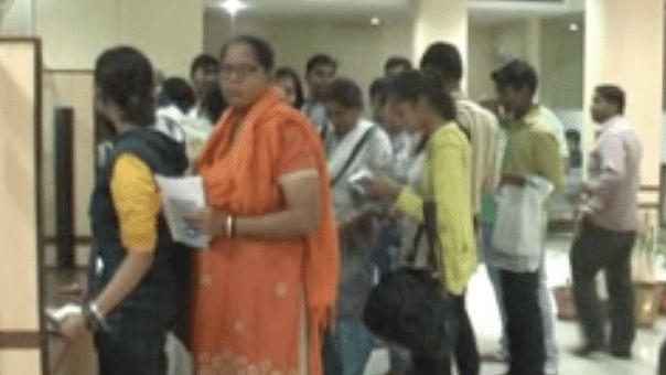 People wait in queues for hours at banks to exchange money (Photo: The Quint)