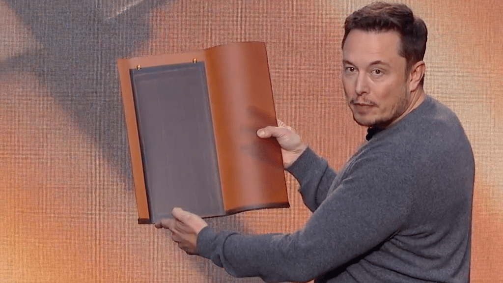 Elon Musk demonstrates some of his solar tiles. (Photo Courtesy: Screenshot from Tesla Video)