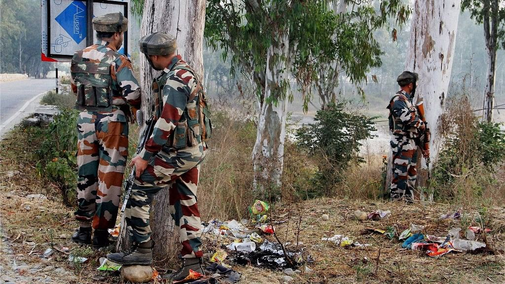 Security personnel take position during the gun-battle with terrorists at Nagrota army camp. (Photo: PTI)