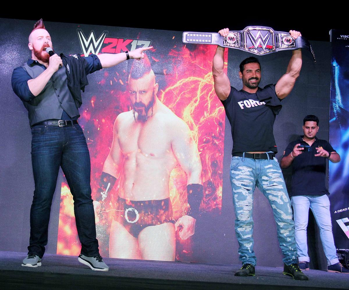 John beams as he has always been a big fan of wrestling. (Photo: Yogen Shah)