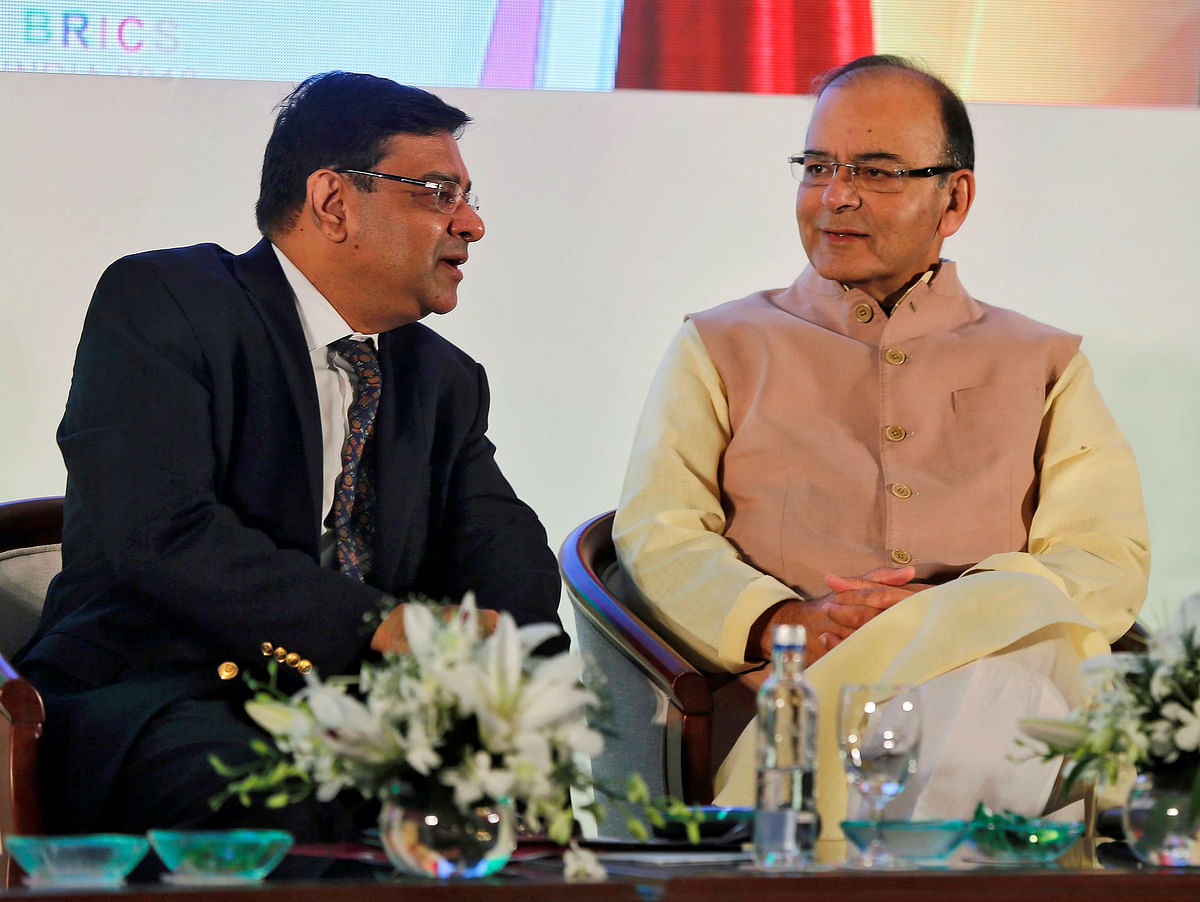 The Reserve Bank of India (RBI) Governor Urjit Patel speaks with Finance Minister Arun Jaitley (R) at a seminar in Mumbai, India, 13 October 2016. Patel has not spoken publicly about demonetisation yet. (Picture: Reuters)