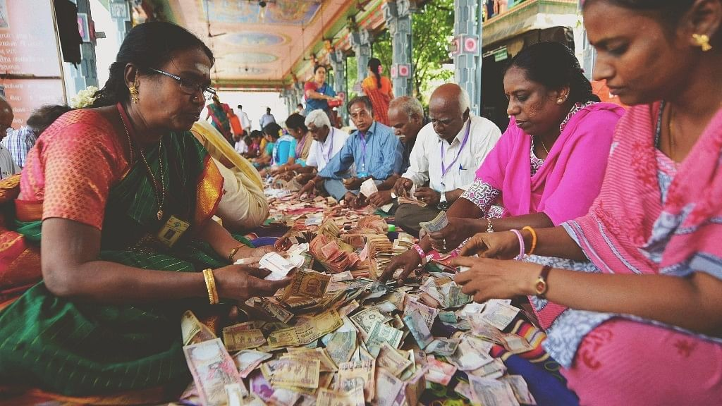 Members of Sri Kabaleeswarar Temple Trust counting the funds deposited in Hundi by devotees, following the demonetisation of Rs 500 and Rs 1,000 notes, in Chennai. (Source: PTI)