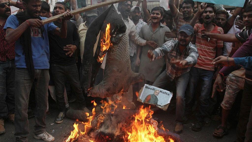 Pakistani Protesters Set Indian Flag On Fire, Burn Modi Effigy