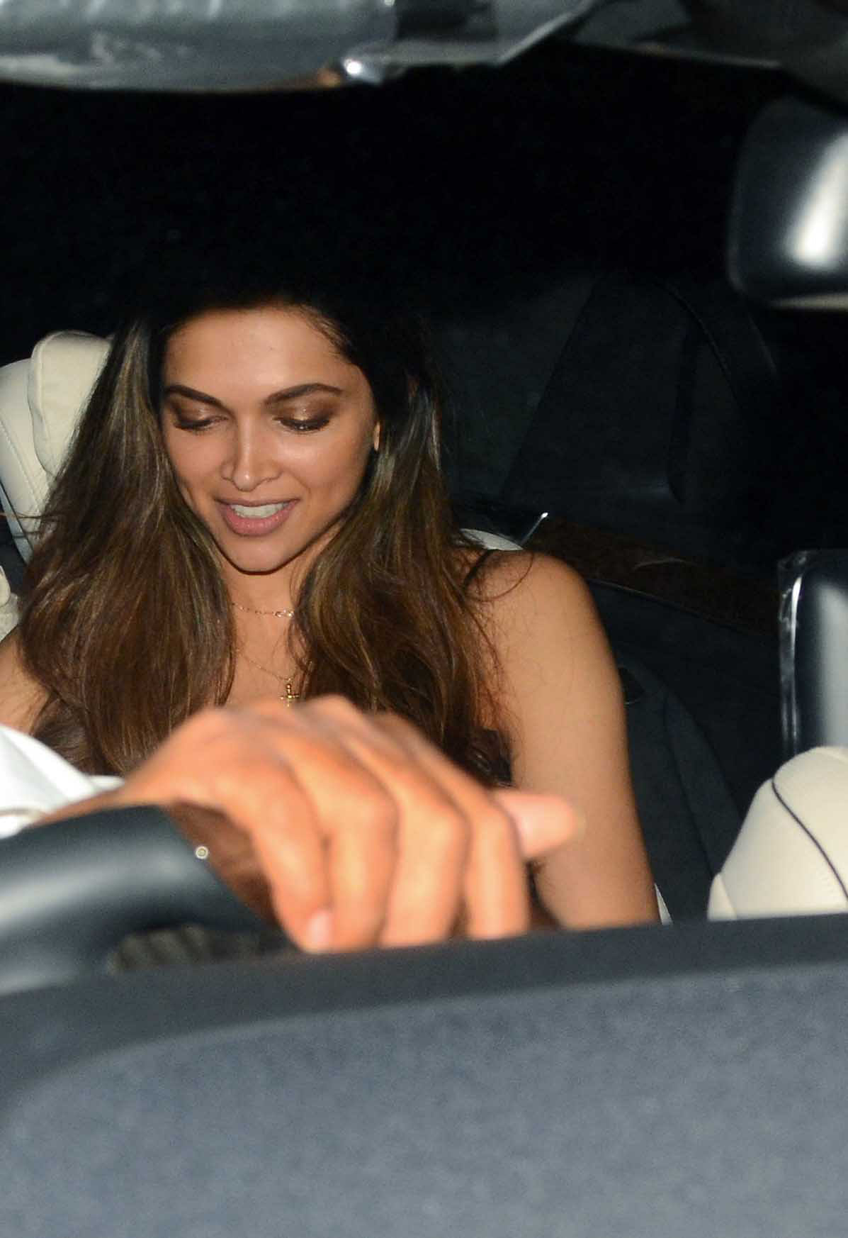 Deepika catches up with some text messages on her phone. (Photo: Yogen Shah)