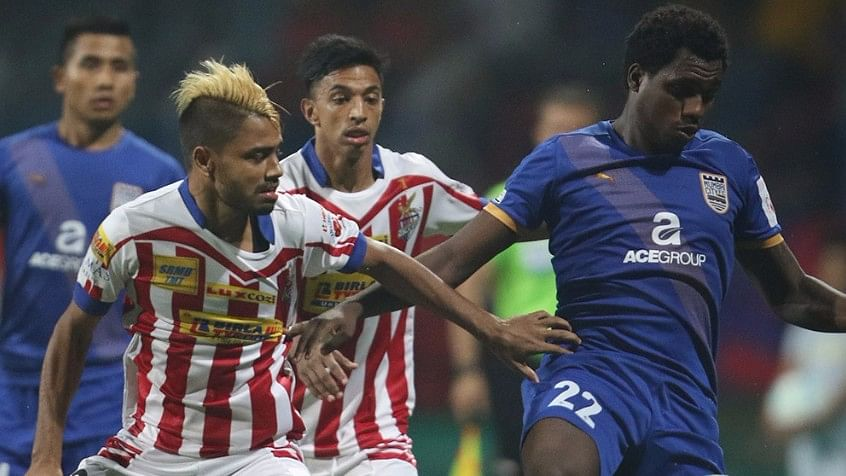 Cafu of Mumbai City FC is challenged by Prabir Das of Atletico de Kolkata during their match on 25 October. (Photo: Indian Super League)