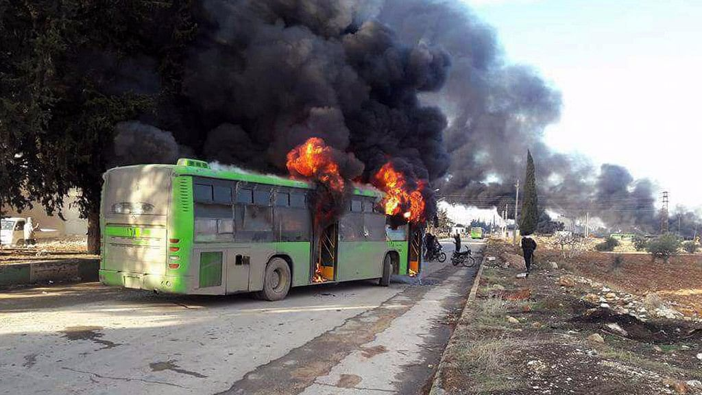 """Videos posted on social media showed bearded men with guns cheering and shouting """"God is great"""" after torching the green buses. (Photo: AP)"""