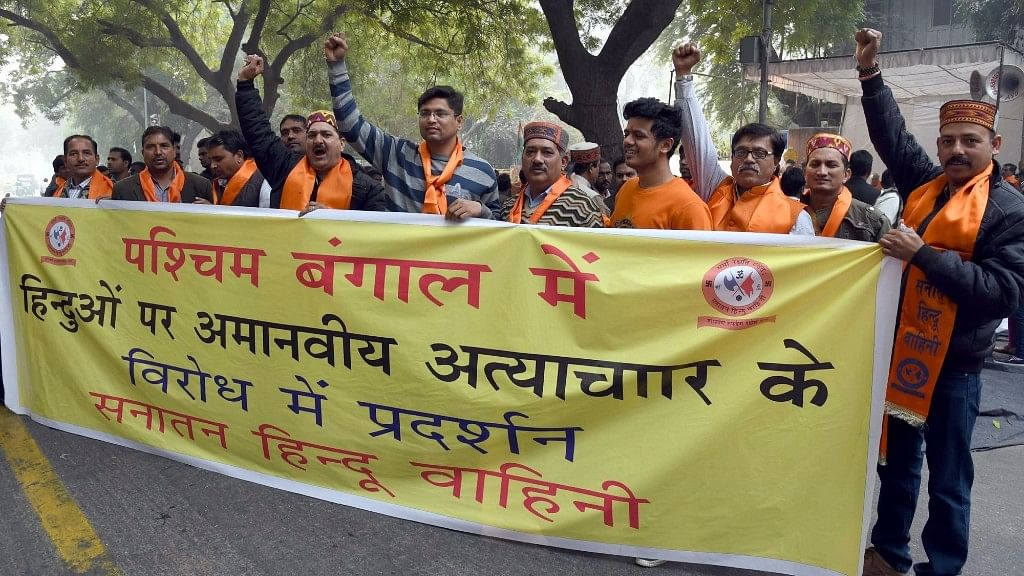 Right wing activists stage a demonstration against Dhulagarh violence in New Delhi. (Photo: IANS)