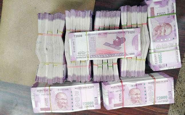The new notes were found after Income Tax raids were conducted across Bengaluru (Photo: AP)