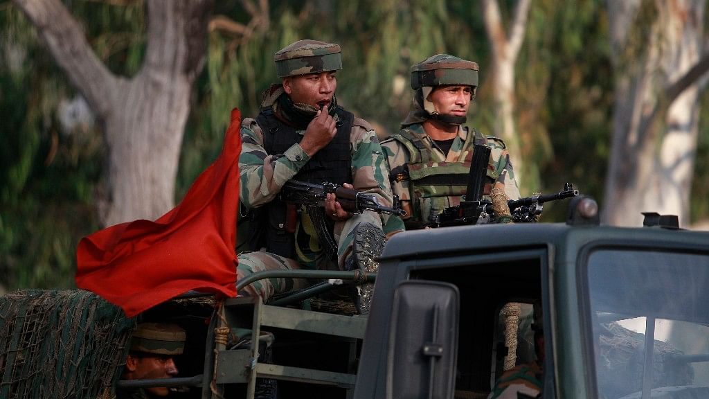 Soldiers patrol a road near the site of the terror attack in Nagrota,  Jammu, on 29 November 2016. (Photo: AP)