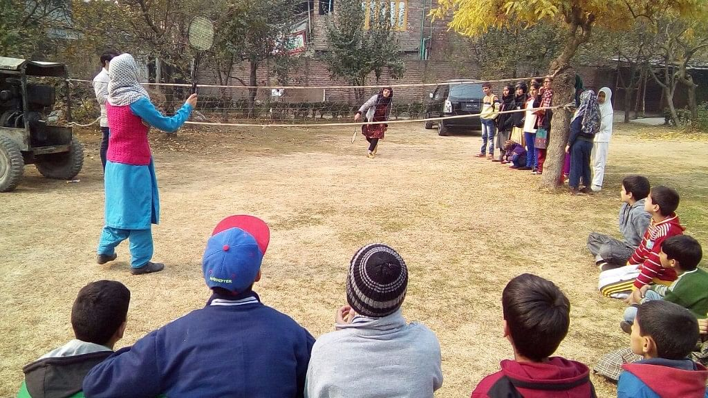 Students play badminton as they take a break from studies. (Photo: Sheik Majid/ <b>The Quint</b>)