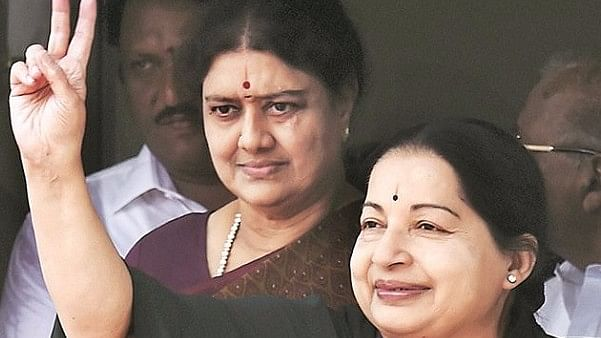 Sasikala Natarajan stands behind Tamil Nadu Chief Minister J Jayalalithaa. (Photo: The News Minute)