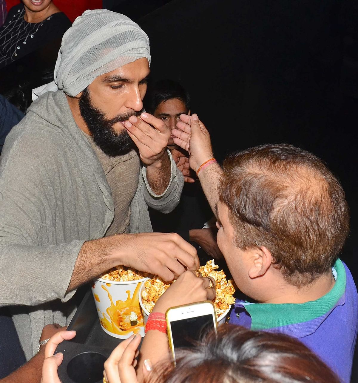 Ranveer also steals popcorn from fans. (Photo: Yogen Shah)