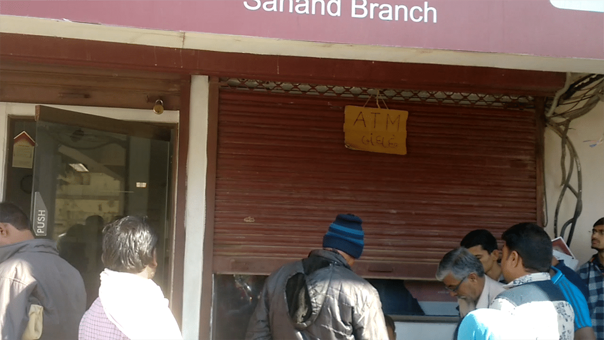 Limited cash forces a bank to shut down an ATM in Sanand, Gujarat.