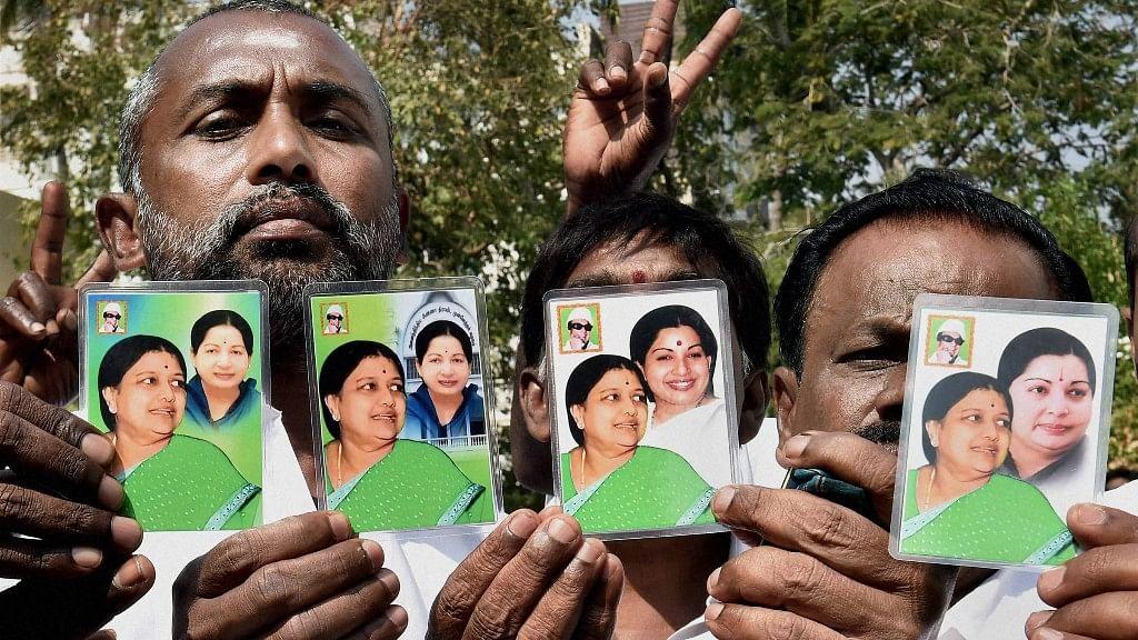 People hold up cards showing Sasikala Natarajan with late Tamil Nadu CM J Jayalalithaa in Chennai. (Photo: PTI)