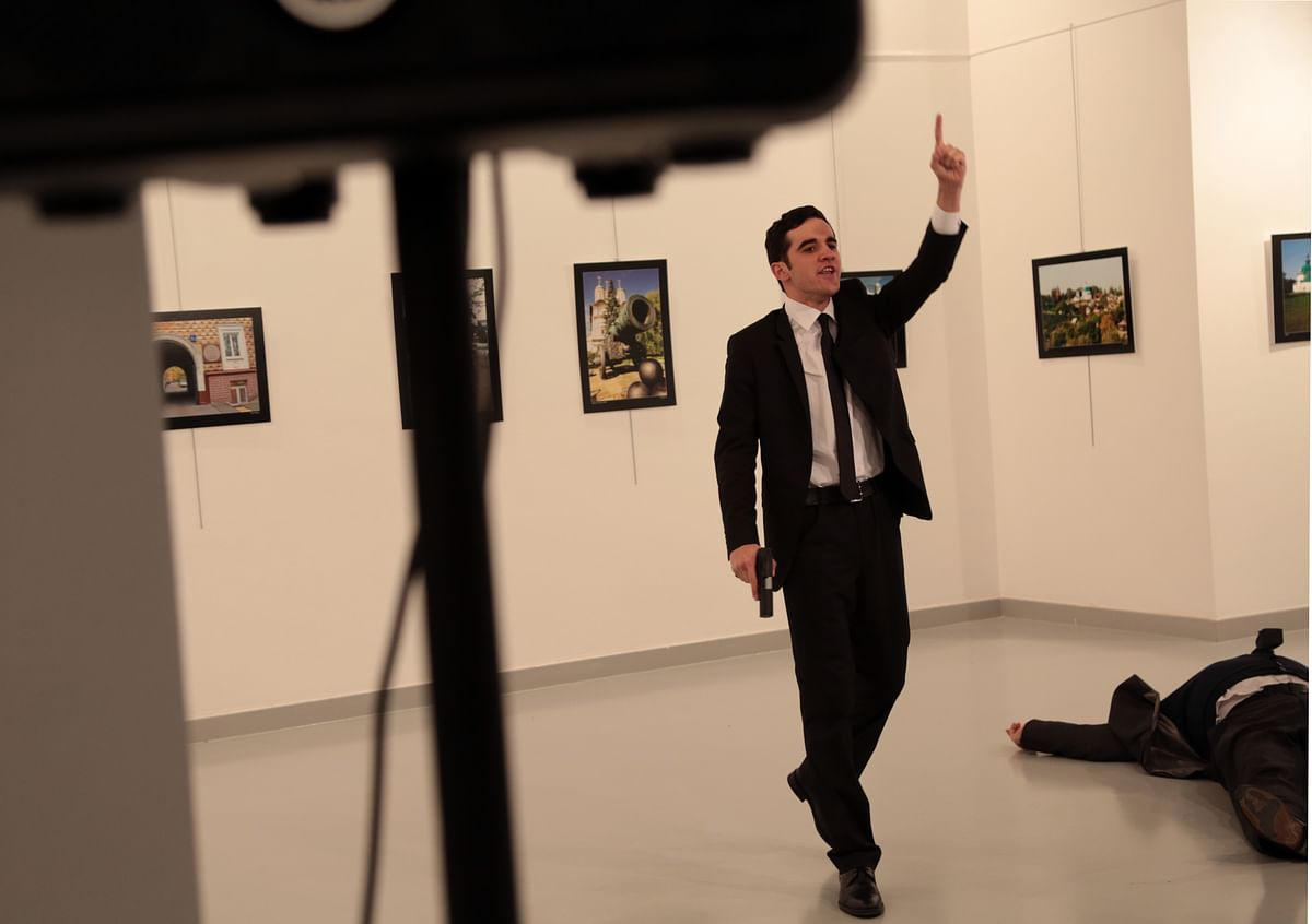 Image of the assassin after the ambassador was shot. (Photo: AP)
