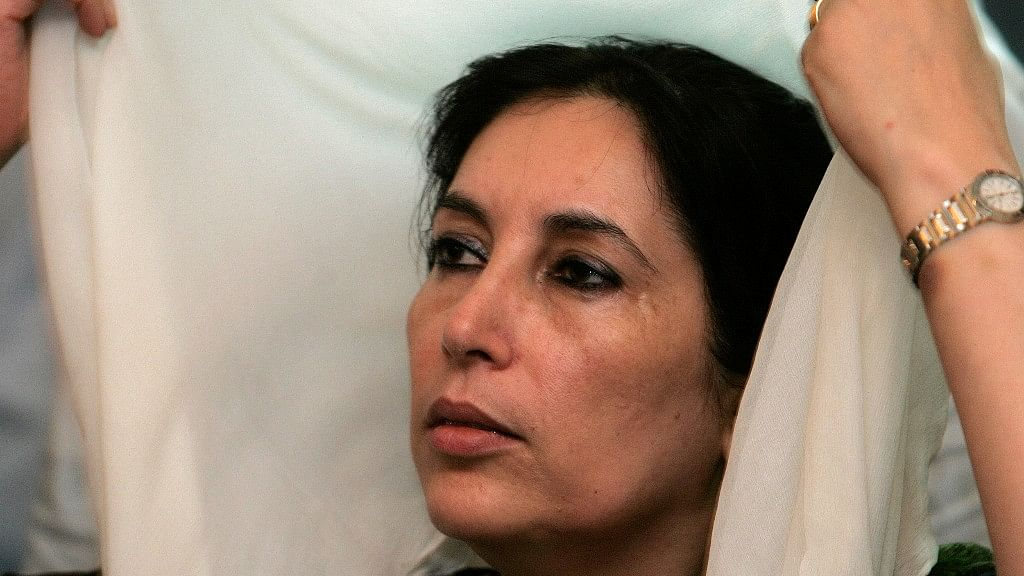 Pakistan's former prime minister Benazir Bhutto holds her headscarf as she talks to members of the media at her residence in Karachi on 22 October  2007.
