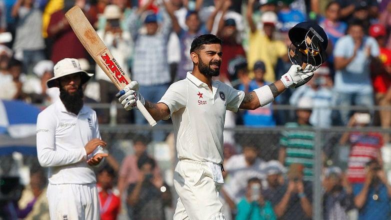 Virat Kohli celebrates after scoring a hundred. (Photo: BCCI)
