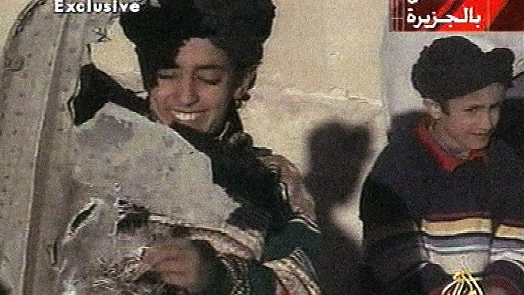 In this image from video broadcast by television station Al-Jazeera on 7 November 2001, the young boy, left, is identified as Hamza bin Laden. (Photo: AP)