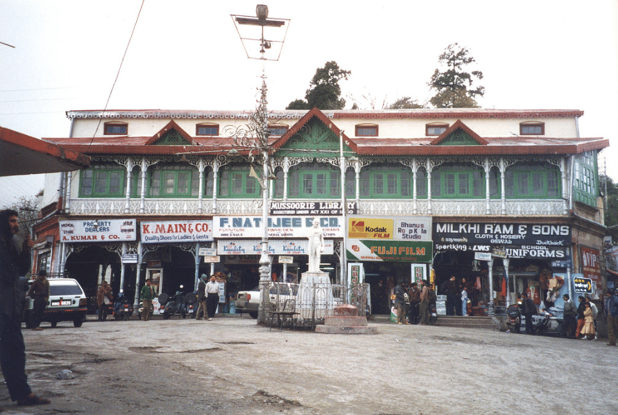 """The green-and-white facade of the library stands as a standing relic of the Raj Era amidst the modern structures that now dot the Mall Road. (Photo Courtesy: <a href=""""https://c1.staticflickr.com/1/192/535947559_ace662d972_b.jpg"""">flickr.com</a>)"""