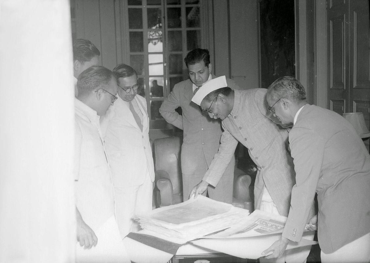 "Presentation ceremony of the Constitution of India, Prem Behari Narain Raizada showing &amp; presenting the original manuscript to the first president of India, Rajendra Prasad. (Photo courtesy: <a href=""https://plus.google.com/photos/118092972326422169139/album/6222871843021072913/6222871841199942338?authkey=CKSmtqy8tYvLfw"">Prem Foundation</a>)"