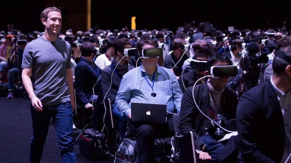 Mark Zuckerberg, walking around a crowd immersed in virtual reality. (Photo Reuters)