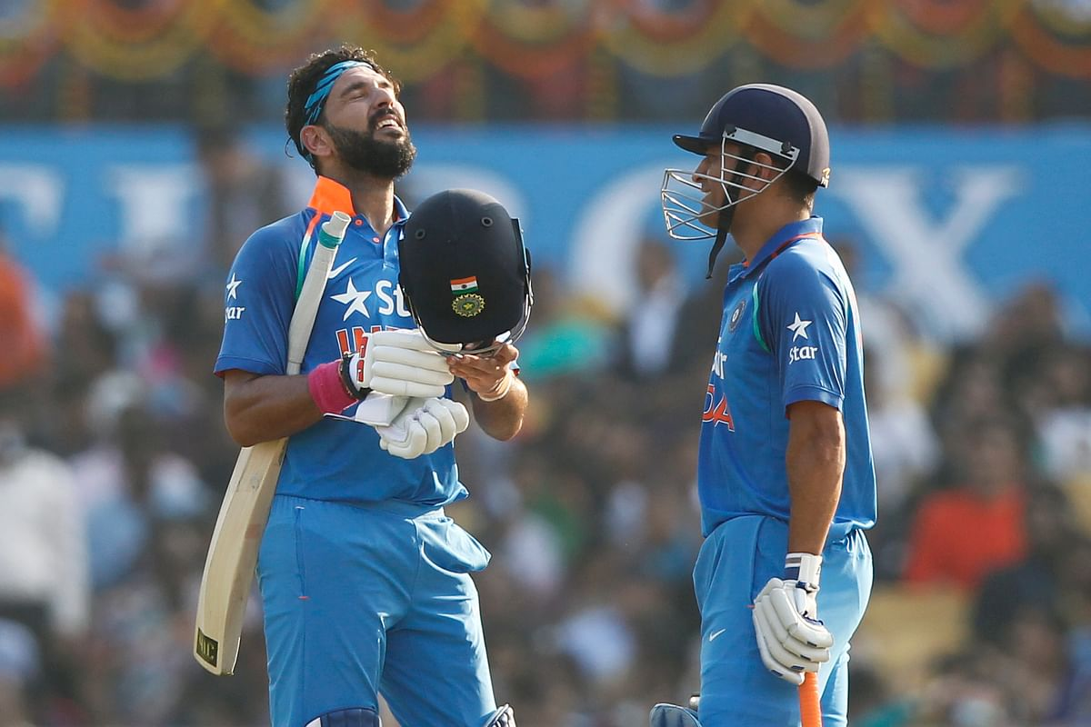 Yuvraj Singh (L) celebrates his century with MS Dhoni (R) during the second ODI against England. (Photo: BCCI)