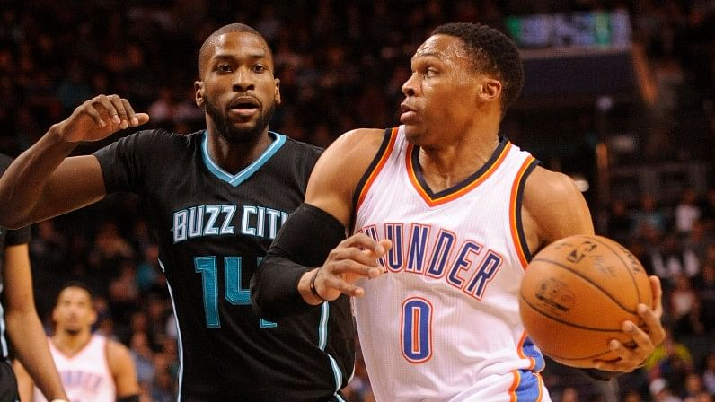 Oklahoma City Thunder guard Russell Westbrook (0) drives to the basket as he is defended by Charlotte Hornets forward Michael Kidd-Gilchrist (14) during the first half at the Spectrum Center. (Photo: Reuters)