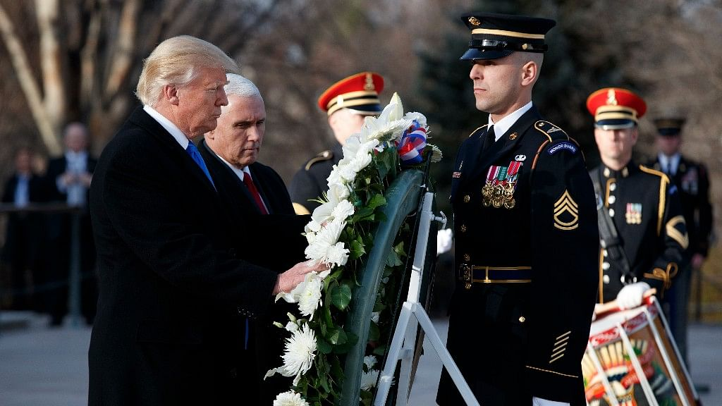 President-elect Donald Trump, accompanied by Vice President-elect Mike Pence places a wreath at the Tomb of the Unknowns. (Photo: AP)