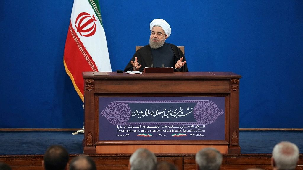"""Iran's president, Hassan Rouhani, has compared talk of renegotiating its nuclear accord to """"converting a shirt back to cotton,"""" and says US President-elect Donald Trump's talk of doing so is """"mainly slogans."""" (Photo: AP)"""