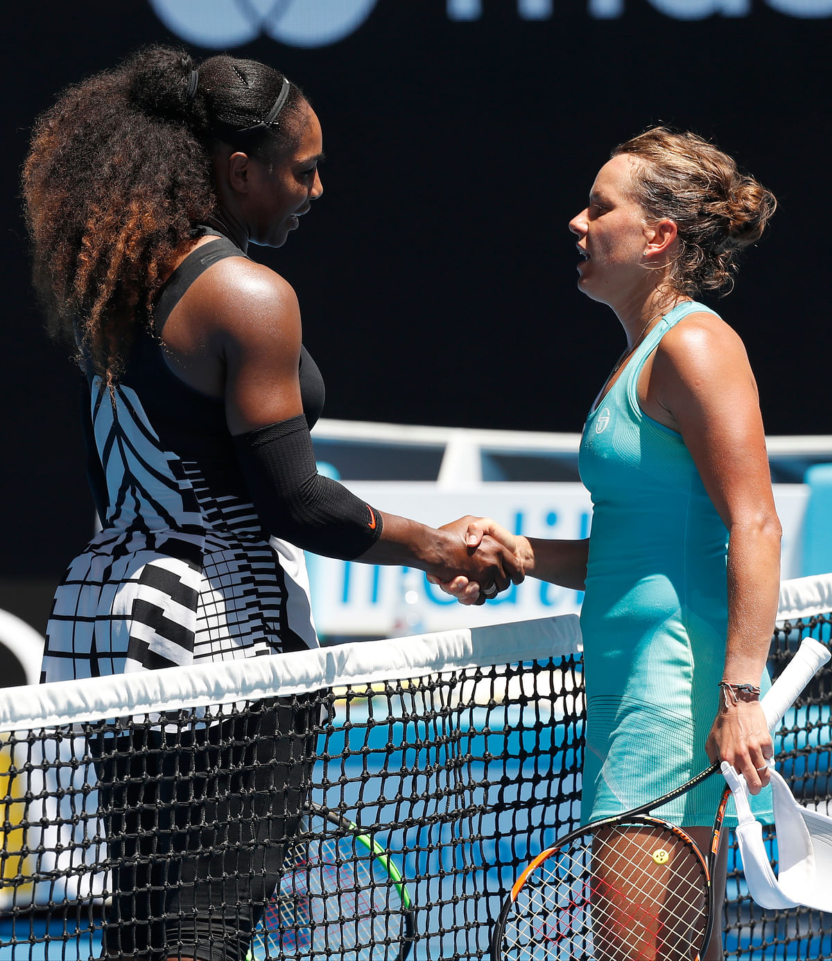 United States' Serena Williams, left, is congratulated by Barbora Strycova of the Czech Republic after winning their fourth round match at the Australian Open. (Photo: AP)