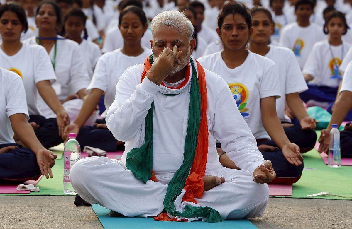 Prime Minister Narendra Modi performs yoga with others during a yoga camp to mark the International Day of Yoga, in New Delhi, India on June 21, 2015. (Picture: Reuters)