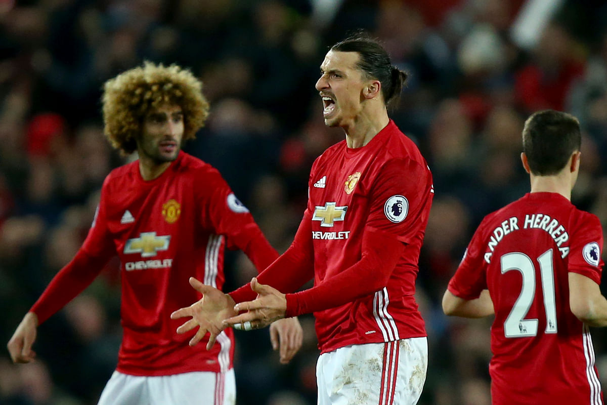 Manchester United's Zlatan Ibrahimovic, second left, celebrates scoring his side's first goal against Liverpool. (Photo: AP)