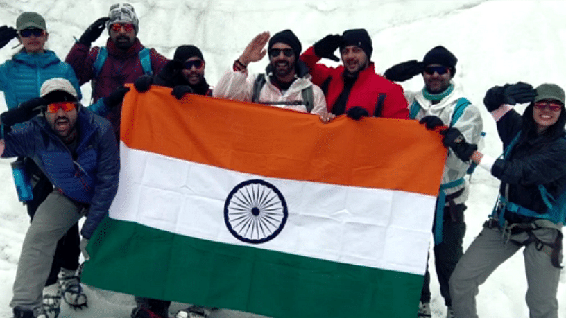 The <i>Salute Siachen </i>team celebrates with the Indian flag at the end of the mission. (Photo courtesy: Eros Now)