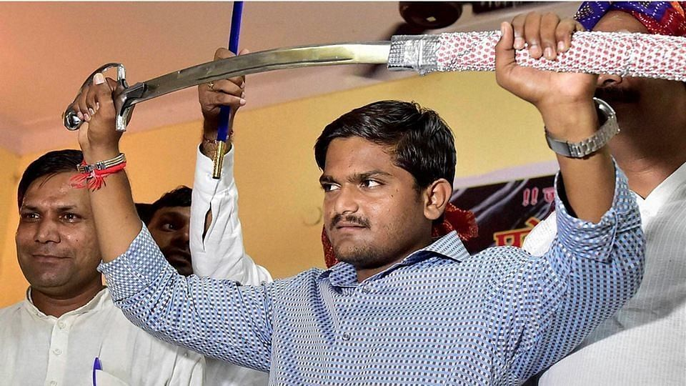Hardik Patel brandishes a sword presented to him by Gujjars in New Delhi. (Photo: PTI)