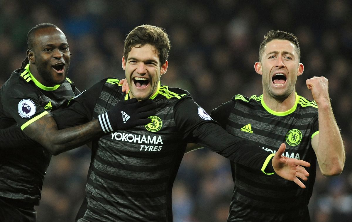 Chelsea's Marcos Alonso, centre, celebrates scoring his second goal during the Premier League match against Leicester City. (Photo: AP)