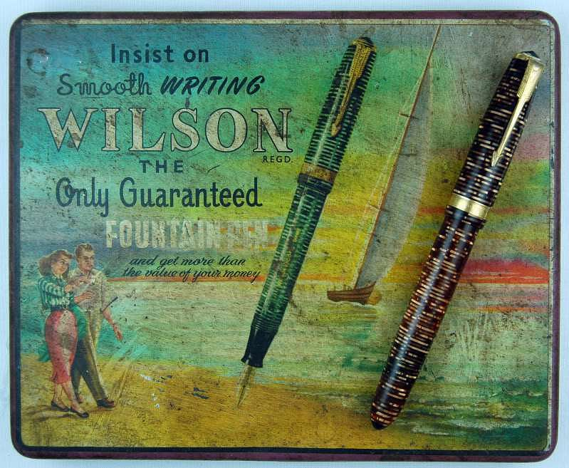 """A colourful Wilson box used to display and sell ten pens at a time, seen here with one on top. (Photo courtesy: <a href=""""https://munsonpens.wordpress.com/2009/07/20/wilson-fountain-pen-advertising/"""">Munson Pens' Blog</a>)"""