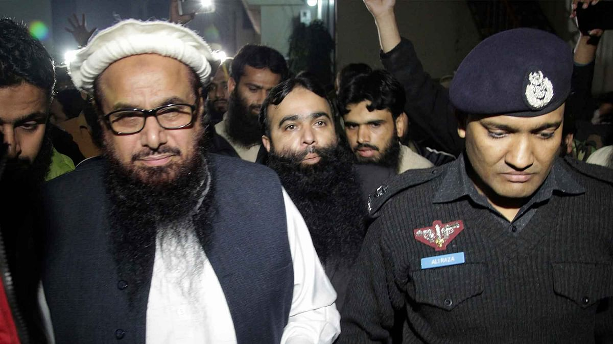 Hafeez Saeed talks to the press after the six-month house arrest order. (Photo: AP)