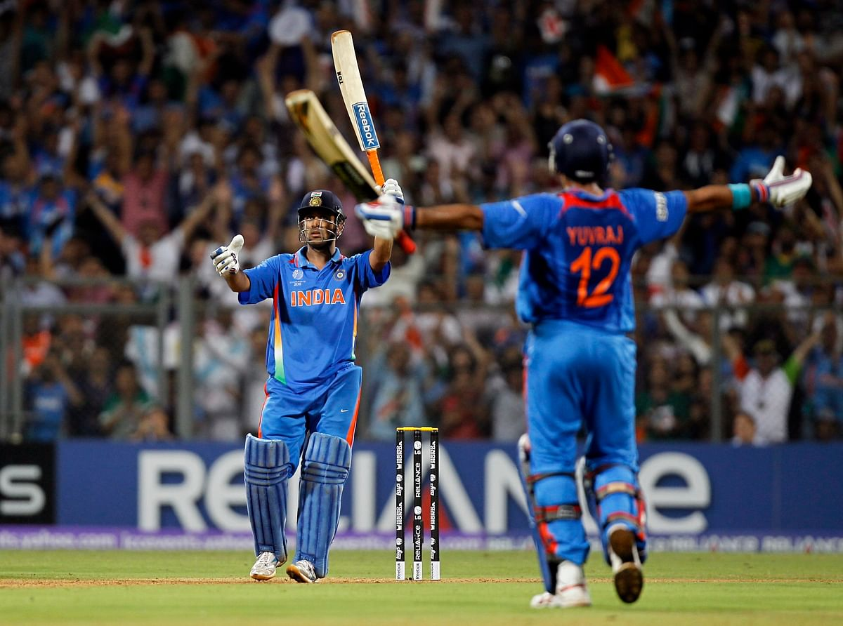 Yuvraj Singh celebrates as MS Dhoni wraps up the 2011 World Cup final against Sri Lanka with a six. (Photo: Reuters)