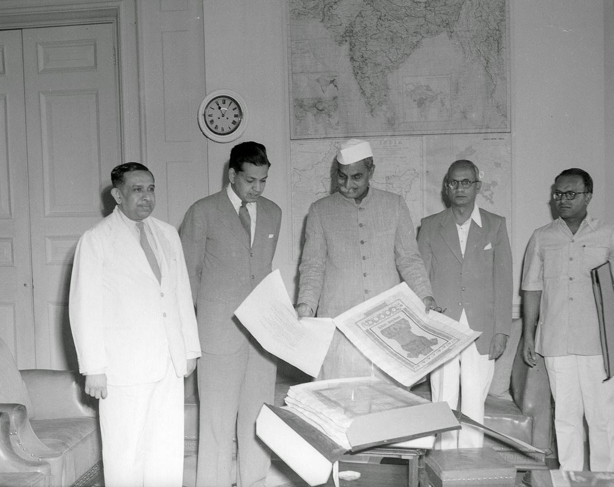 "Presentation ceremony of the Constitution of India, Prem Behari Narain Raizada showing &amp; presenting the original manuscript to the first president of India, Rajendra Prasad. (Photo courtesy: <a href=""https://plus.google.com/photos/118092972326422169139/album/6222871843021072913/6222871841498834370?authkey=CKSmtqy8tYvLfw"">Prem Foundation</a>)"