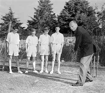 Cariappa tries his hand at cricket with Australian boys.
