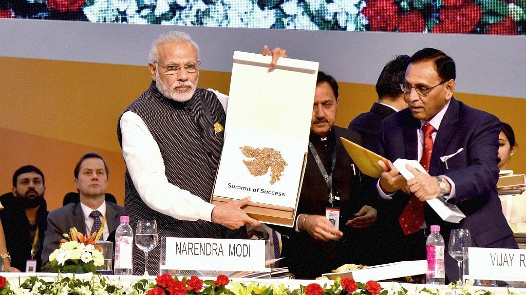 Prime Minister Narendra Modi releases a publication at the inauguration of Vibrant Gujarat Global Summit 2017 in Gandhinagar, Gujarat on Tuesday.