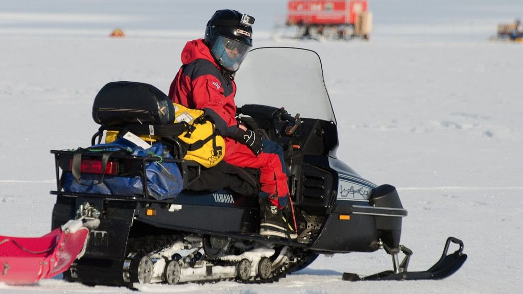 Vikram Goel returns to his research camp on a snowmobile in Antarctica. (Photo Courtesy: Norwegian Polar Institute/Peter Leopold)
