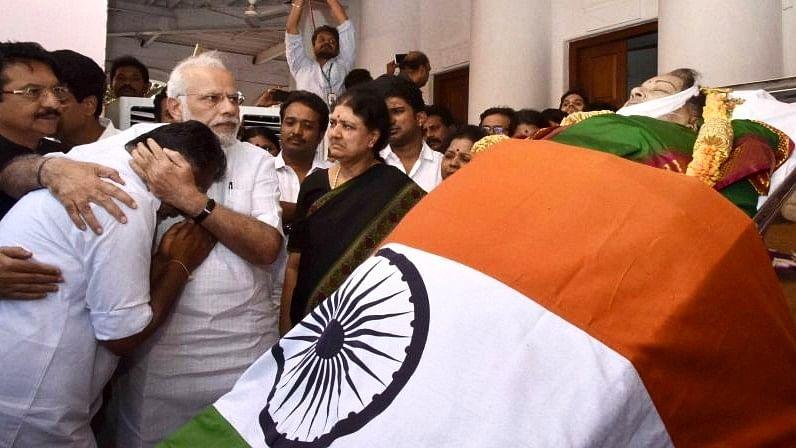 Prime Minister Narendra Modi comforts Panneerselvam after Jayalalithaa's demise as Sasikala watches. (Photo: PTI)
