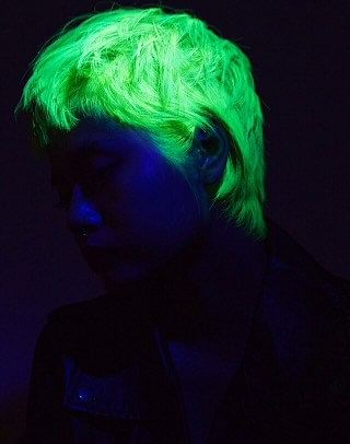 Lir's neon yellow hair glow in the dark, attracting a lot of attention at parties (Photo: Karishma Bedi Photography/ Rod Anker Salons)