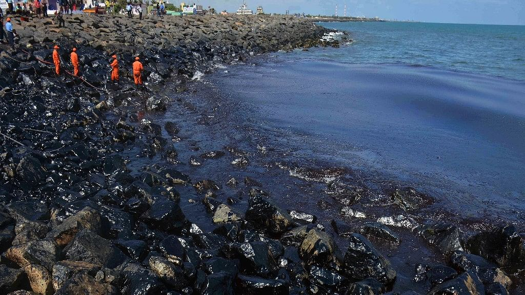The crew of two ship which caused a massive oil spill in Chennai by colliding off the city's coast are being interrogated to determine responsibility. (Photo: AP)