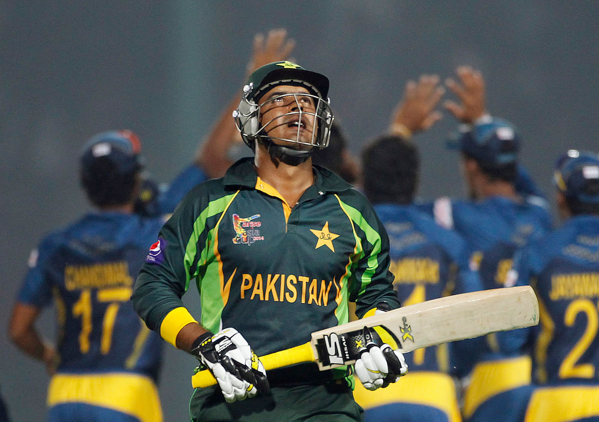 Pakistan's Sharjeel Khan leaves the field as Sri Lanka's fielders celebrate his dismissal during their one-day international (ODI) match at the Asia Cup in 2014. (Photo: Reuters)