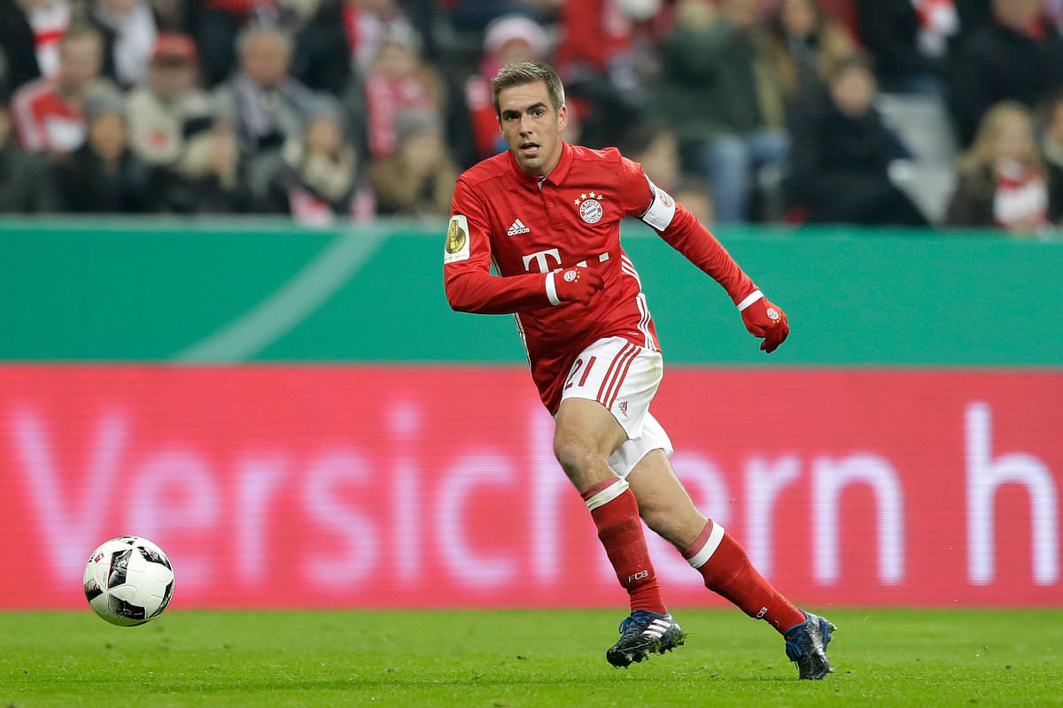 Bayern's Philipp Lahm controls the ball during the German Soccer Cup match between FC Bayern Munich and VfL Wolfsburg at the Allianz Arena stadium in Munich. (Photo: AP)