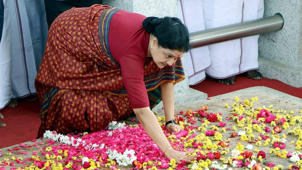 Sasikala slams her palm at Jayalalithaa's shrine at Marina beach in Chennai.