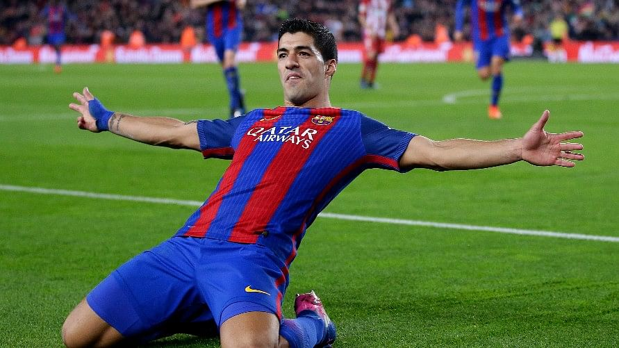 Barcelona's Luis Suarez celebrates after scoring the opening goal during the the Copa del Rey semifinal second leg match against Atletico Madrid. (Photo: AP)